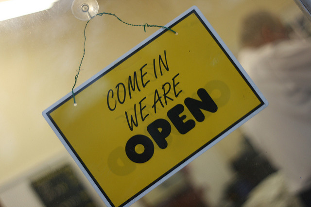 "Image of a ""Come in we are open"" sign."